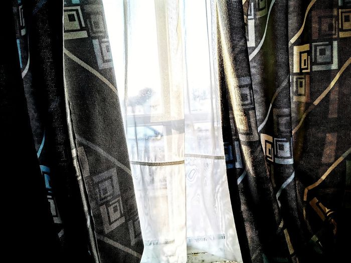 Close-up of curtain hanging from window