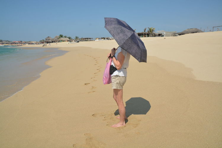 Full length of young woman walking on beach