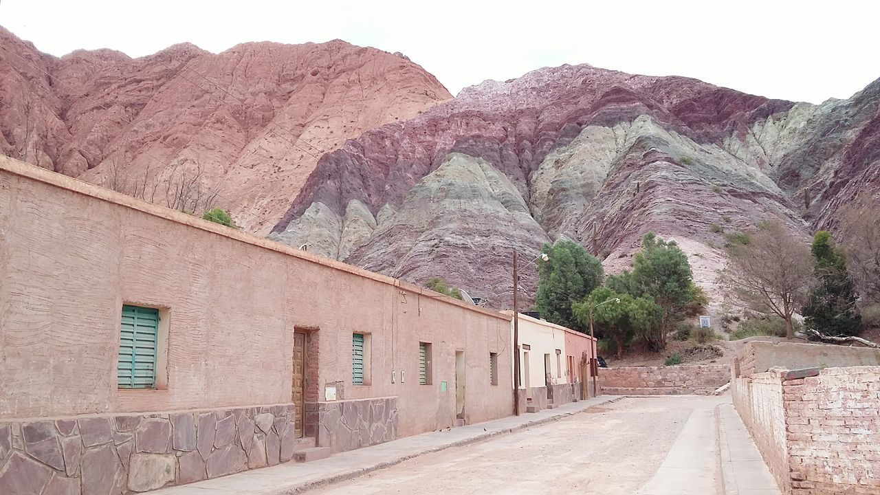 mountain, outdoors, day, mountain range, nature, no people, built structure, architecture, clear sky, building exterior, beauty in nature, landscape, scenics, tree, arid climate, sky