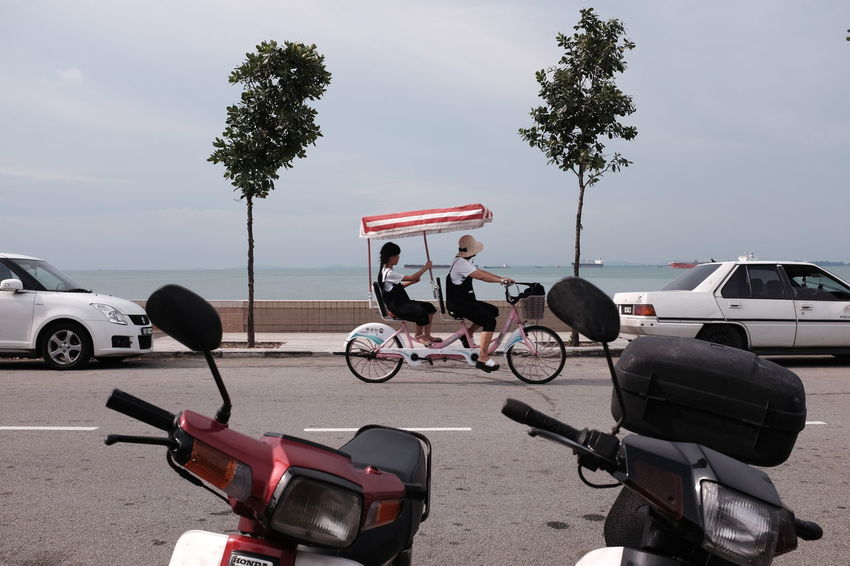 Walking around Fort Cornwallis Park in George Town, Penang, Malaysia. Georgetown Penang Bicycle Land Vehicle Lifestyles Mode Of Transport Nature Outdoors Penang Malaysia Riding Sky Togetherness Transportation Travel Tandem Tandem Bike Connected By Travel An Eye For Travel