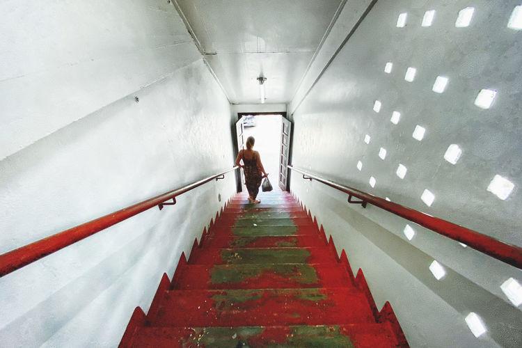 Rear view of man walking in subway