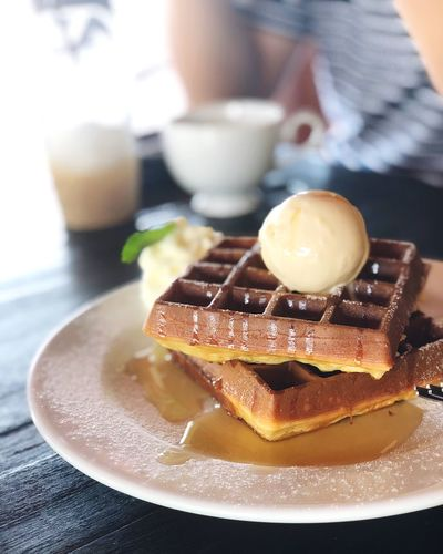Close-up of waffles in plate on table