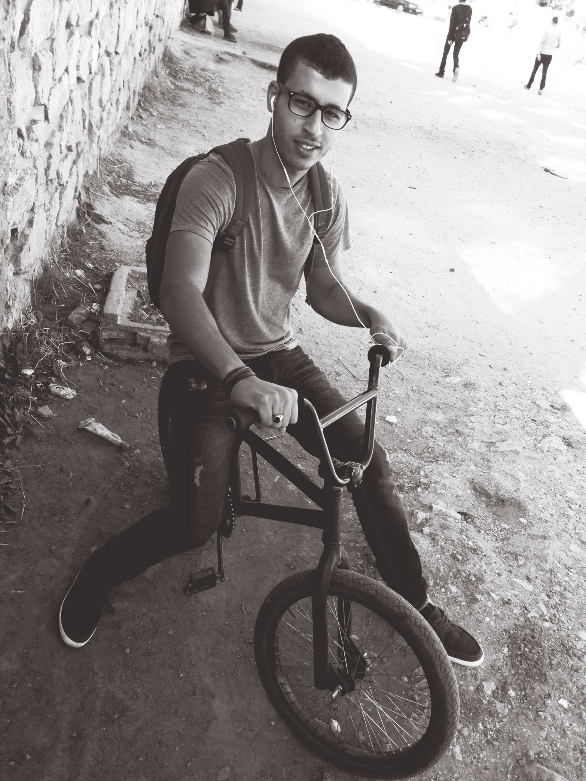 lifestyles, full length, casual clothing, leisure activity, person, street, land vehicle, bicycle, transportation, childhood, mode of transport, young adult, boys, sitting, front view, side view, road, shadow