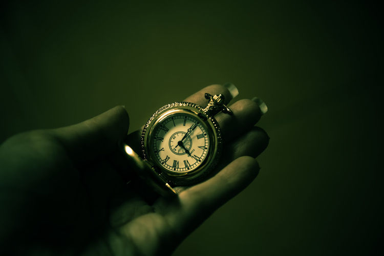 Human Hand Hand Human Body Part One Person Watch Holding Time Studio Shot Body Part Indoors  Real People Close-up Unrecognizable Person Wristwatch Human Finger Pocket Watch Finger Accuracy Personal Perspective Clock Black Background Personal Accessory Luxury Human Limb