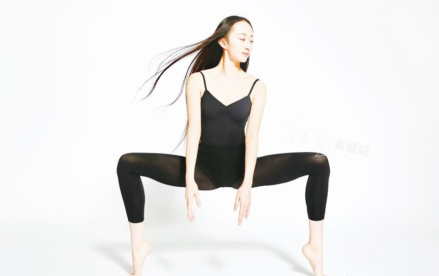 M-Posture White Background Studio Shot Full Length One Person Young Adult Long Hair Sitting Young Women Sport Women Indoors  One Young Woman Only One Woman Only Human Body Part Flexibility Adult People Adults Only Day Beautiful Woman Hot Pants