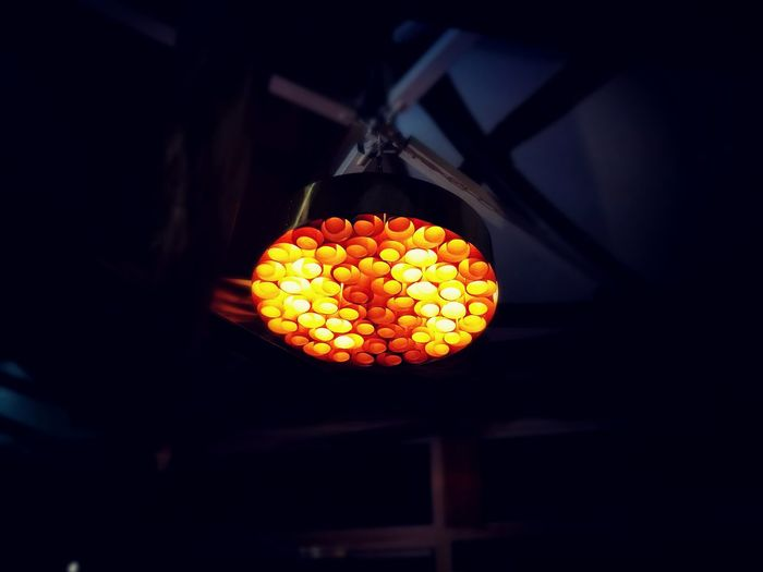 Low angle view of illuminated lantern hanging from ceiling