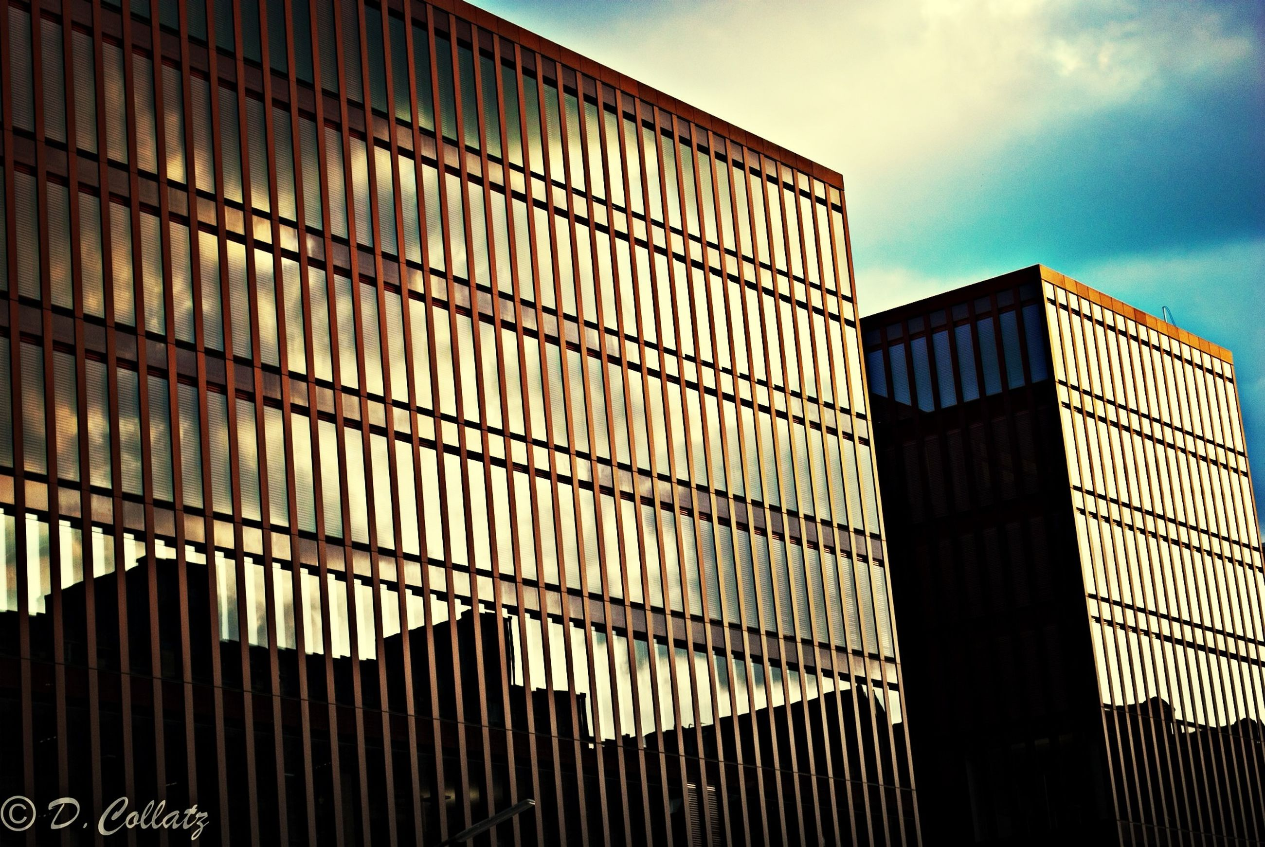 architecture, built structure, building exterior, sky, low angle view, modern, cloud - sky, city, building, pattern, window, cloud, office building, outdoors, day, no people, sunlight, glass - material, repetition, design