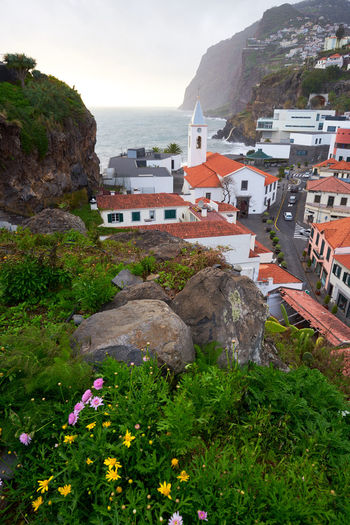 View of São Sebastião church with Cape Girão, in Câmara de Lobos, Madeira Architecture Church City Cityscape Madeira Panorama Panoramic Portugal Portuguese Travel View Aerial Aerial View Building Cabo Girão Cape  Girao Ilha Island Landscape Mountain Outdoors Religion Religious  Seascape