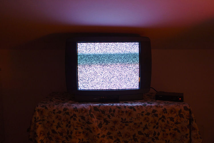 Close-up of tv at home