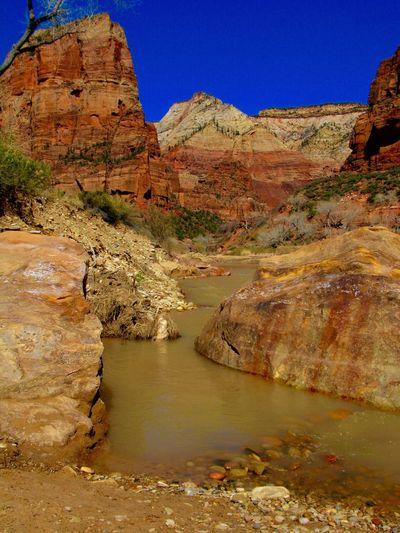 River Flowing Through Cliffs