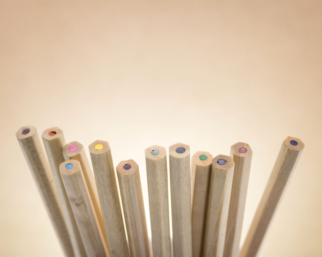 Colors pencils on brown background. A group of wooden pencils color. Paint Pencils Vivid Art Backgrounds Bottom Bottomview Close-up Color Colorful Draw Education Indoors  Many No People Object Pencil Pencil Art Pencil Drawing Still Life Studio Shot White Background Wood - Material Wood Colours Wooden Colors