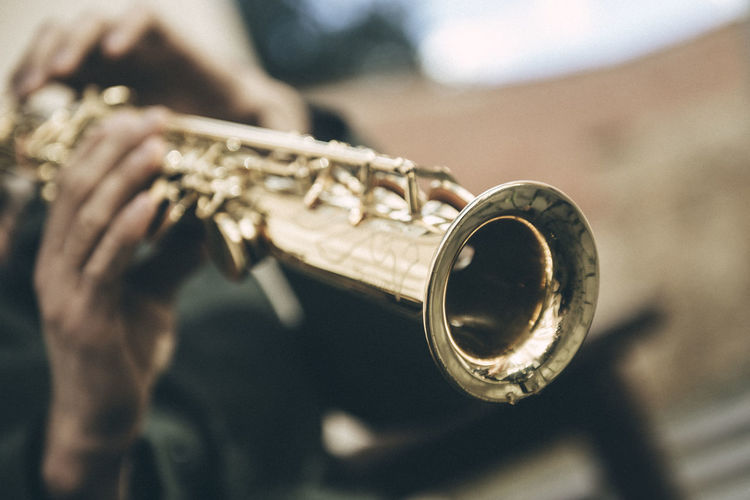 Close-Up Of Person Playing Saxophone