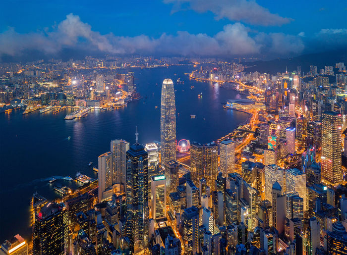 Aerial view of Hong Kong Downtown. Financial district and business centers in smart city, technology concept. Top view of skyscraper and high-rise buildings at night. Architecture Business City Cityscape Downtown Drone  Hong Kong Residential  Top Aerial View Apartments Architecture Bay Building Building Exterior Buildings Built Structure City Cityscape Cloud - Sky Crowd Downtown District Financial District  High Angle View High Rise Building Illuminated Metropolis Modern Nature Office Building Exterior Outdoors Residential District Sky Skyscapers Skyscraper Tall - High Travel Destinations Water