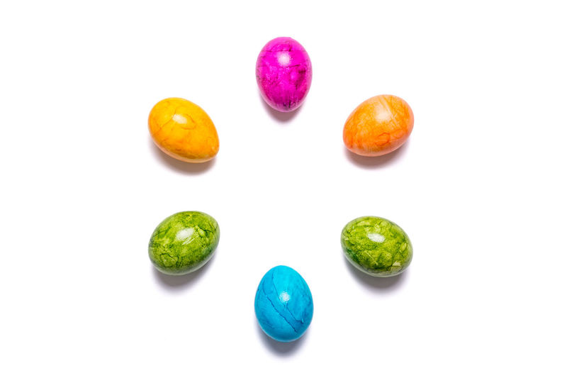 Close-up of multi colored candies on white background