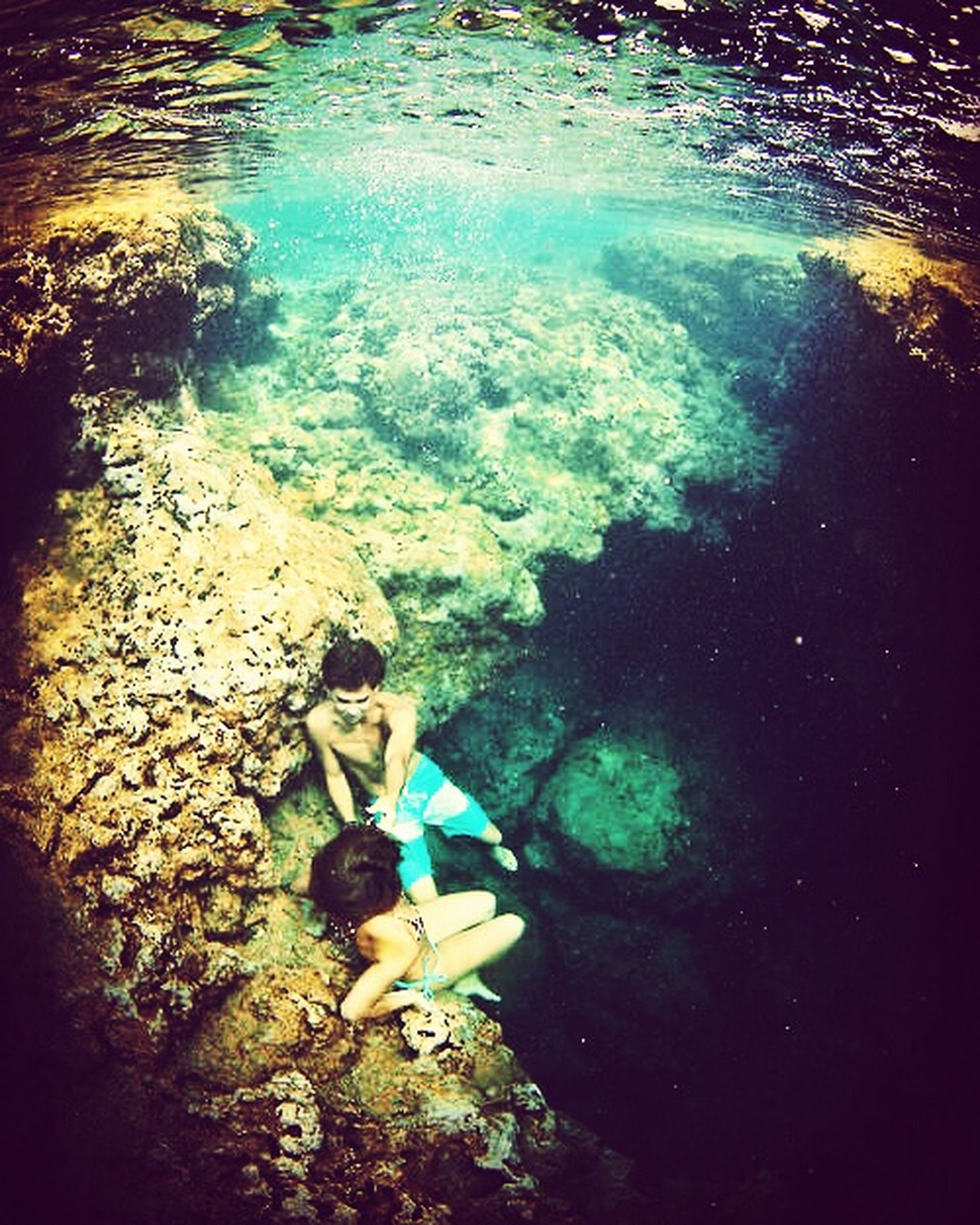 water, high angle view, one person, real people, leisure activity, swimming, day, full length, outdoors, women, nature, beauty in nature, underwater, young women, young adult, one young woman only, undersea, people