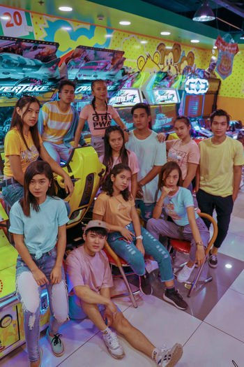 Fierce Arcade Fun Shoot Dance Crew Full Length Portrait Women Smiling Men Cheerful Sport Young Women Looking At Camera Friend Reunion - Social Gathering Colleague