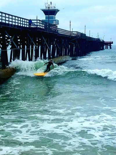 Surfer Cutting Wave Cloudy Day Raining Perseverance Check This Out Water Ocean Nature Eyem Gallery EyeEm Nature Lover This Week On Eyeem Waves Nature_collection Still Life Photography Simplicity Nature_perfection Beauty In Nature Natural Sky Pier Beautiful Nature Enjoy The New Normal