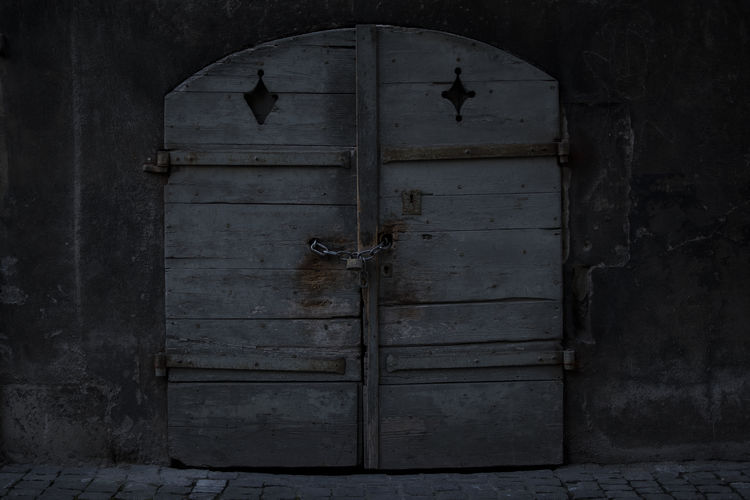 Locked door Abandoned Architecture Architecture And Art Architecture Details Architecture Photography Building Exterior Closed Door Dark Dark Art Dark Photography Door Entrance EyeEmNewHere No People Old House Old Town Old-fashioned Wood - Material