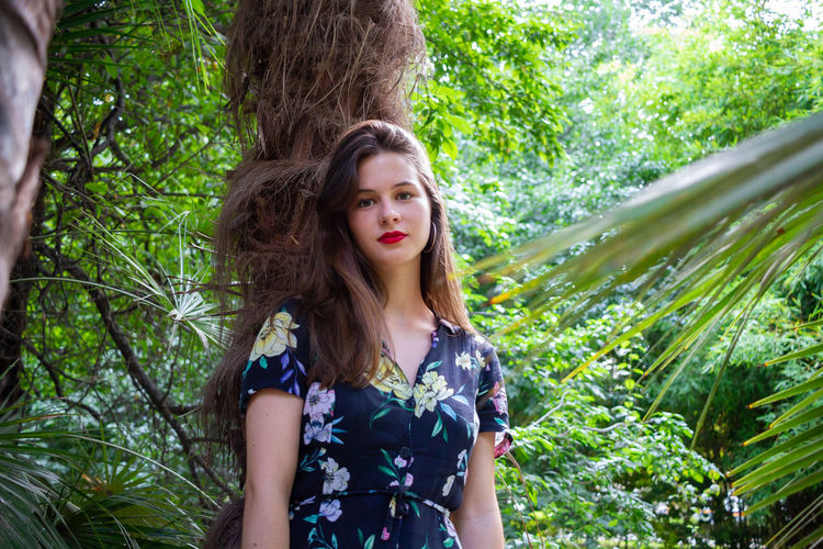 Portrait of a beautiful young woman in forest