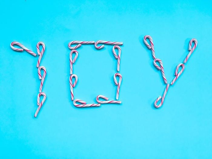 Close-up of love against blue background