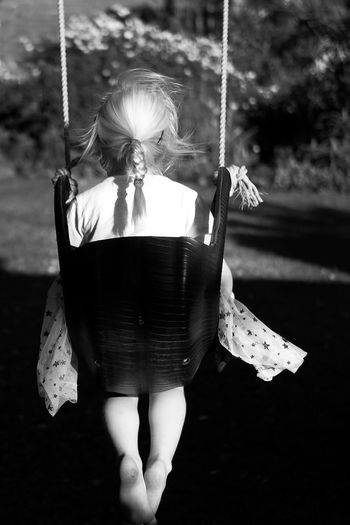 Childhood bliss Happiness Blonde Child Swinging One Person Real People Focus On Foreground Lifestyles Outdoors Playground