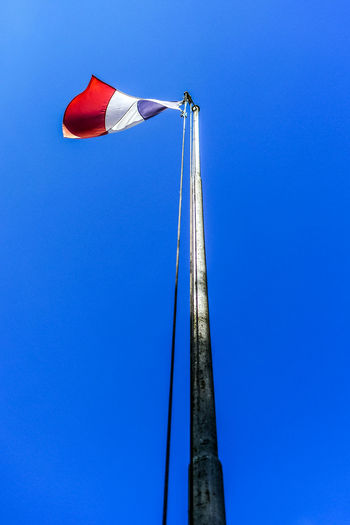 Blue Sky Low Angle View Clear Sky Day Copy Space Red Nature No People Outdoors Pole Metal Sunlight Tall - High Built Structure Flag Architecture Environment Directly Below France🇫🇷