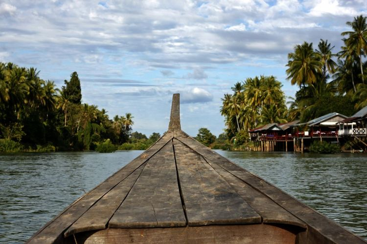 Four Thousand Islands Kayakking Architecture Beauty In Nature Boat On Mekong River Boat On The River Built Structure Cloud - Sky Day Four Thousand Islands Nature Nautical Vessel No People Outdoors Palm Tree Scenics Sea Sky Transportation Tree Water Wood - Material