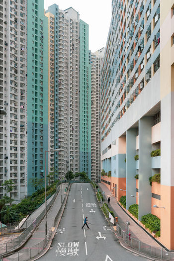 Colorful One Person Hong Kong Architecture EyeEm Best Shots EyeEm Gallery EyeEm Selects Built Structure Architecture Building Exterior Road City Direction Sign Transportation Building The Way Forward Day Office Building Exterior Symbol Nature Road Marking Sky Residential District Diminishing Perspective Motor Vehicle Modern Outdoors Skyscraper The Architect - 2019 EyeEm Awards The Street Photographer - 2019 EyeEm Awards The Minimalist - 2019 EyeEm Awards My Best Photo