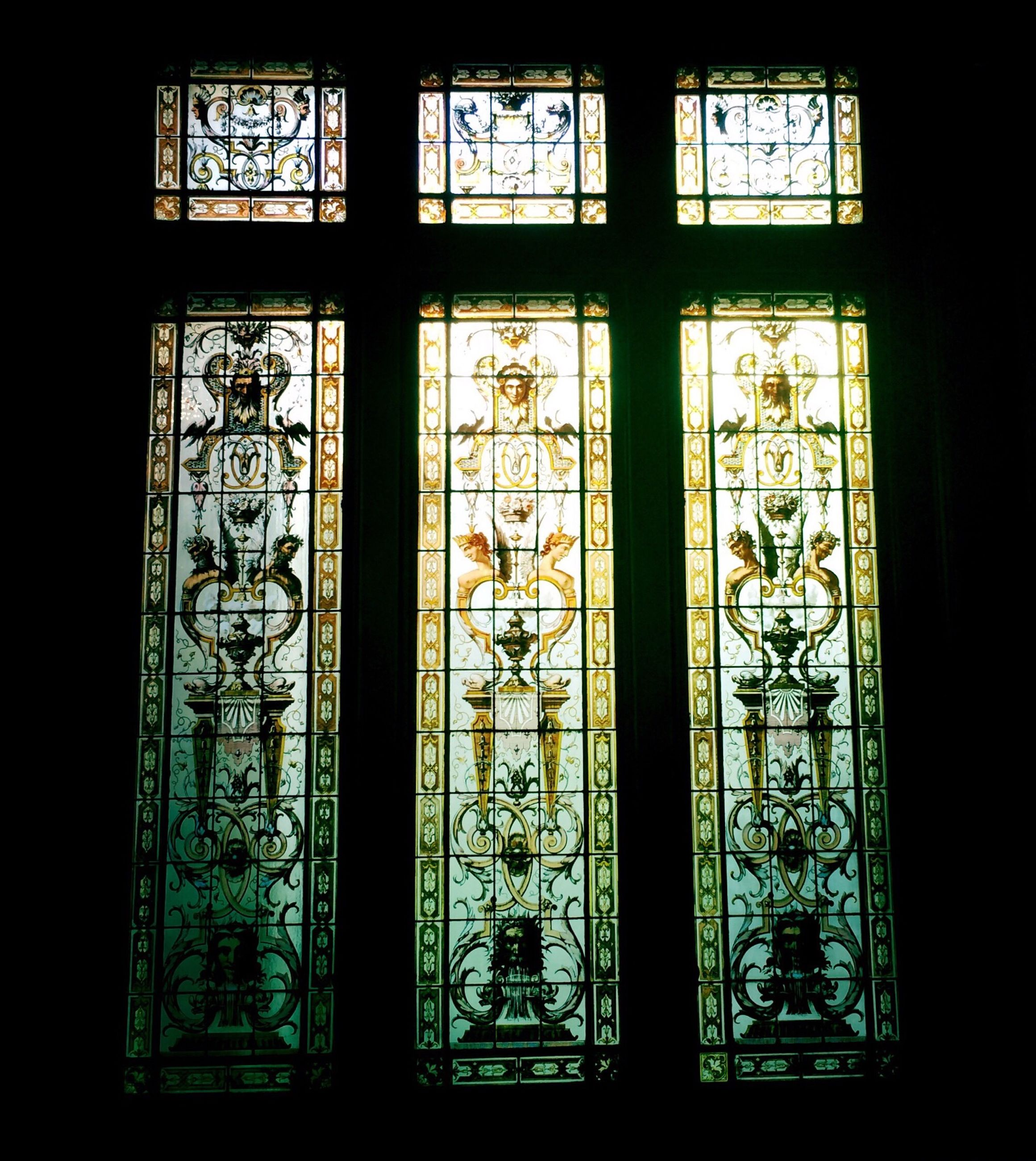 indoors, window, glass - material, transparent, stained glass, architecture, built structure, design, pattern, home interior, church, closed, no people, dark, religion, glass, ornate, day, door, house