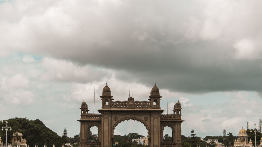 The entrance of Mysore Palace ... Cloud - Sky Architecture Travel Destinations Built Structure Sky Arch Travel Nature The Past Tourism City History Building Exterior No People Monument Triumphal Arch Day Outdoors India Mysore Palace Historic Karnataka Entrance Overcast