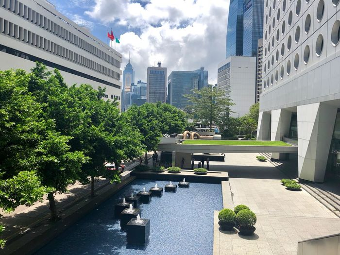 Oasis in the Financial Hub Financial District  Streetphotography Urban Exploration HongKong Travel Destinations Architecture Building Exterior Built Structure City Building Plant Sky Day Nature Cloud - Sky Office Building Exterior Sunlight Outdoors No People Growth Office City Life