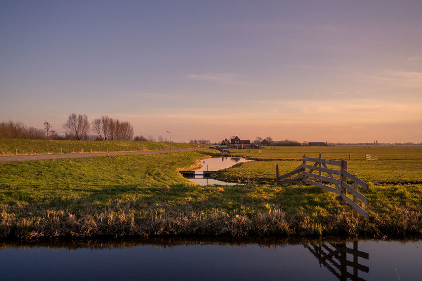 Agriculture Architecture Beauty In Nature Environment Field Lake Land Landscape Nature No People Non-urban Scene Outdoors Plant Reflection Scenics - Nature Sky Sunset Tranquil Scene Tranquility Water