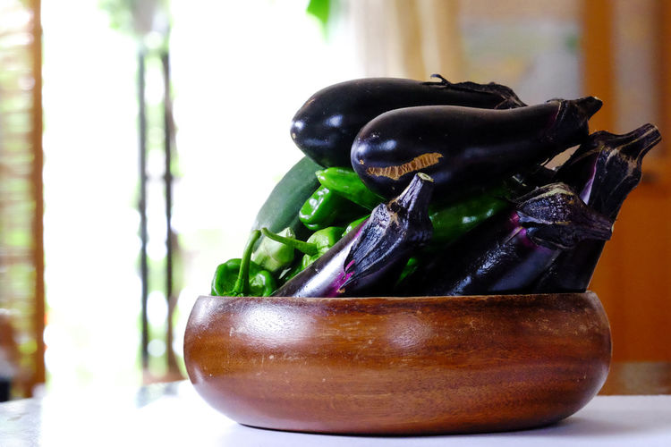 Bokeh Photography Close-up Day Egg Plant Enjoying Life EyeEm Best Shots EyeEm Nature Lover Focus On Foreground FUJIFILM X-T1 Fujifilm_xseries Green Color Green Pepper No People Selective Focus Still Life Summertime 夏野菜