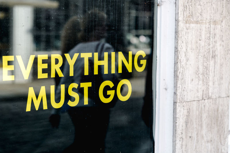 'Everything must go' sentence on front shop window Paint The Town Yellow Reflection Shopping Target Advertisement Architecture Built Structure Clients Close-up Commercial Communication Consumption  Contrast Customers For Sale Front Window Information Must Go Sales Shop Shop Window Text Town Window Yellow