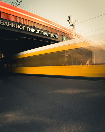 movement in the city of Berlin City Friedrichstrasse City Plane Sunset Public Transportation Flying Yellow Train - Vehicle Rail Transportation Road Sky Subway Platform Subway Station Passenger Train Metro Train Railroad Platform Railroad Station Platform Commuter Train