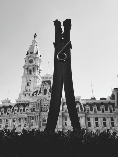 Low angle view of statue in city against clear sky