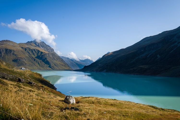Scenic view of lake and mountains against sky silvretta