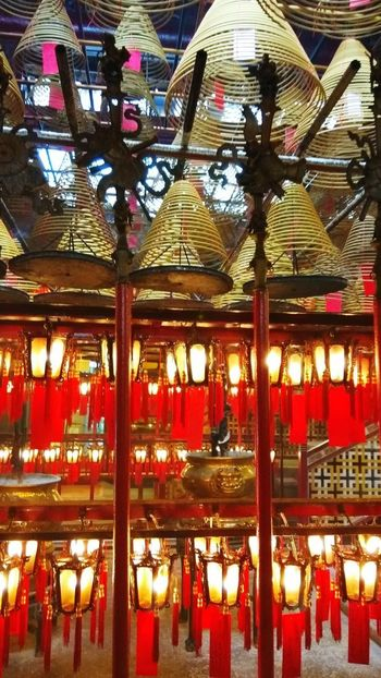 Man Mo Temple Hong Kong Island Chinese Temple Buddhist Temple Inscense Lanterns Red Lantern Indoors  Ceiling Built Structure Architecture No People Illuminated Red Hanging Low Angle View Day Lantern City