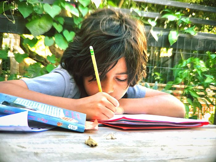 Education Pencil Learning Childhood Writing Headshot School Supplies Outdoors One Person Student Casual Clothing Book Day Child Sitting Paper Homework Concentration Real People Girls IPhone7Plus L. Jeffrey Moore
