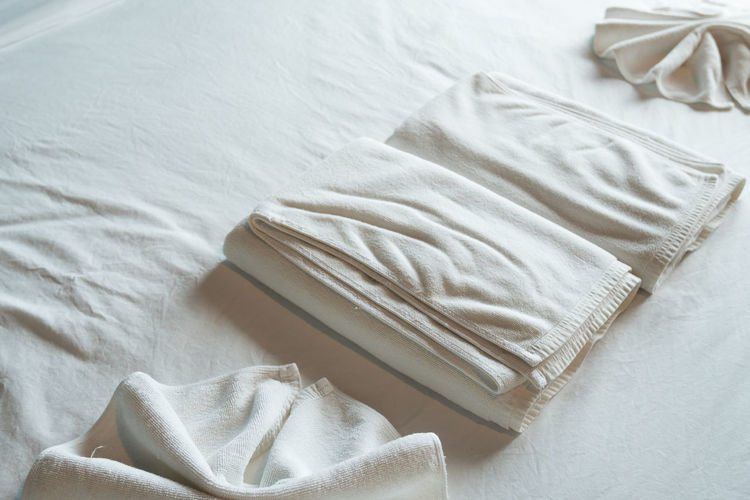 High angle view of towels on bed at hotel