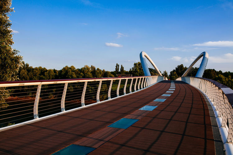 Architecture Blue Blue Sky Boardwalk Bridge - Man Made Structure Built Structure Day Diminishing Perspective Engineering Footbridge Long No People Outdoors Railing Sky TeamCanon The Way Forward Tranquility Tree Vanishing Point Walkway