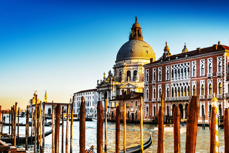 Santa maria della salute by grand canal against clear sky during sunset