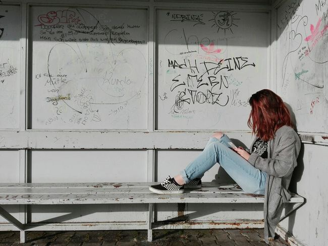 Women Around The World One Person One Young Woman Only Rebellious Red Hair Phone I Dont Care Rebelpunk Side View Sitting Train Station Young Women Eyeem Market Vans Teenage Girls Teens The Photojournalist - 2017 EyeEm Awards BYOPaper!