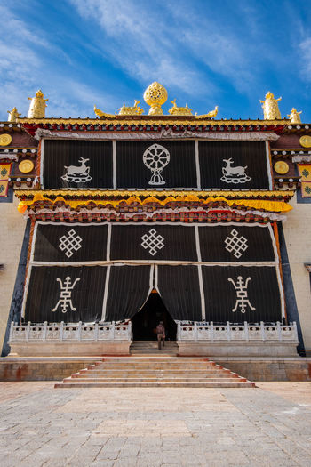 Architecture Built Structure Sky Cloud - Sky Nature Building Exterior Real People One Person Day Text Men Belief Traditional Clothing Communication Religion Outdoors Entrance Adult Temple Shangrila Shangri-La Yunnan China Tibet Mountain