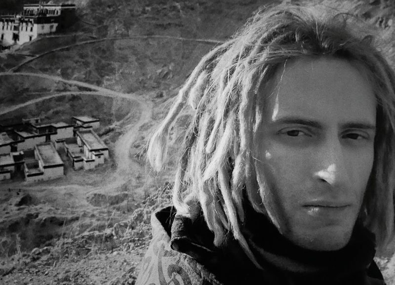 Black and white - ultimate hike in Tibet Dregs Dreglocks Blond Skin Background Focus On Foreground Zen Hiking Ultimate Timeless Passion Copy Space Black And White Contemplative Intense Adventure Man Young Man Features Portrait Headshot Looking At Camera Close-up Head And Shoulders Thinking Pensive Caucasian Thoughtful Stern Attractive This Is My Skin
