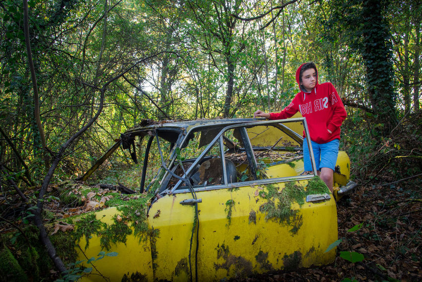Mode Of Transport Transportation Car Vehicle Old Nature Forest Tree Boy Teenager Teenage Boys Abandoned Vintage Cars Vintage Car Rusty Weathered One Person Smiling Day Plant Portrait Young Adult Land Looking At Camera Adult Casual Clothing Front View Happiness Three Quarter Length Standing Emotion Holding Outdoors WoodLand Beautiful Woman