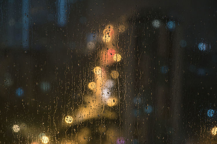 The new year starts with bad weather :( Abstract Dark Darkness And Light Drops Glowing Light Night Nightlights Pane Rain Rain In The City Raindrops Water Weather Wet Window Bokeh Cities At Night Macro Beauty Photography In Motion