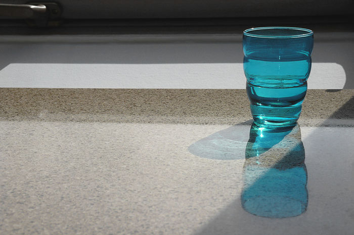 Drink Water Drinking Water Refreshment Glass Glass Of Water Blue Minimalism Minimal Indoors  No People Day Light And Shadow Reflection Reflections Kitchen Kitchen Utensils Light Food And Drink Colors Colours