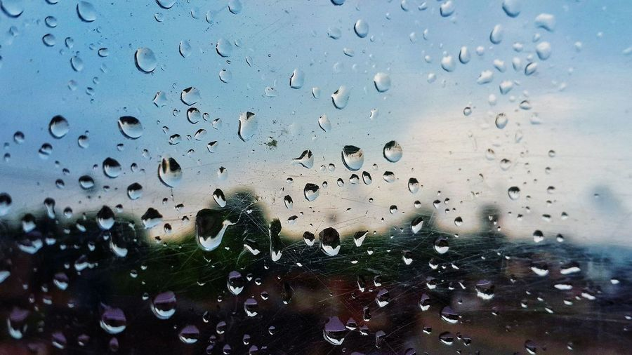 Wet Window Drop Water Rain Indoors  Transparent Glass - Material Close-up Sky Focus On Foreground Full Frame Nature Blue Day No People Fragility