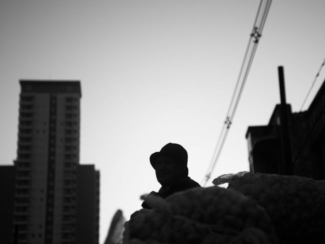 sitting wainting Architecture Sky Real People Clear Sky City Men Sillhouette Hat Dusk